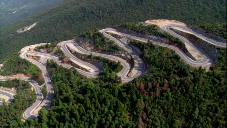 976369307-visions-of-greece-serpentine-hairpin-bend-mountain-road-macedonia-greece